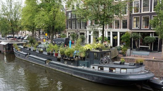 Typical Houseboat on a canal in Amsterdam